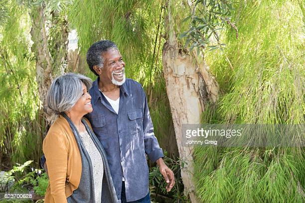 Carefree senior African American couple in garden