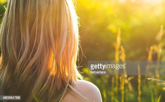 Carefree woman watching sunset : Stock Photo