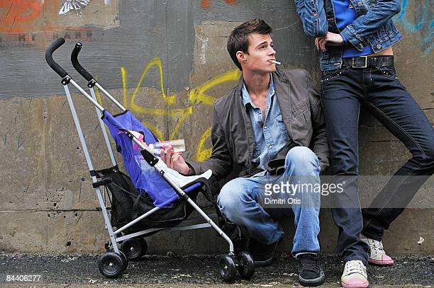 carefree young couple with baby (smoking)