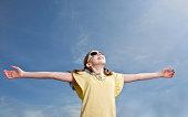 Carefree Young Girl Enjoying Sunshine