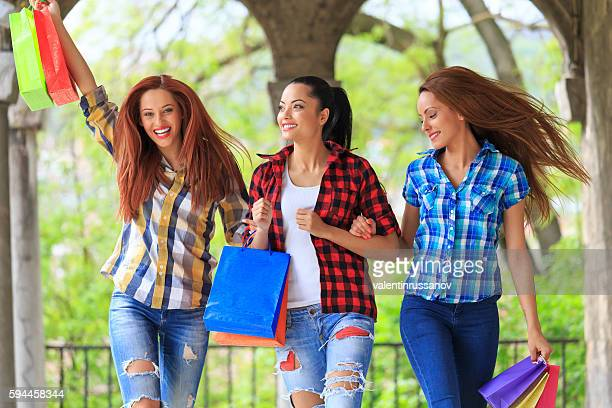 Carefree young women enjoying their purchases
