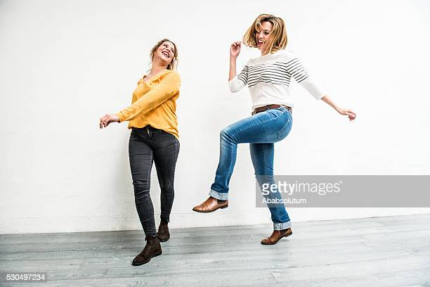 Carefree Young Women Jumping Indoors, Paris, France