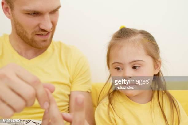 Careful father teaching daughter