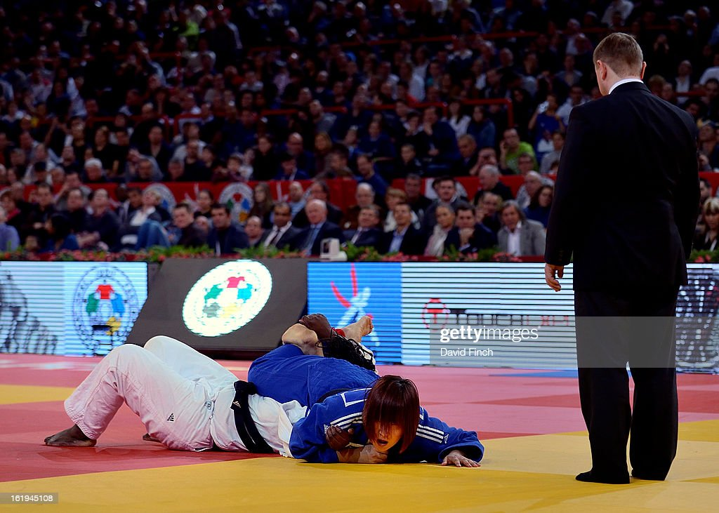 Carefully watched by the referee, Eun Gyeong Kim of South Korea (blue), holds Emile Andeol of France on her back by trapping her head and arm with her entwined legs to win the +78kgs bronze medal at the Paris Grand Slam on day 2, Sunday, February 10, 2013 at the Palais Omnisports de Paris, Bercy, Paris, France.