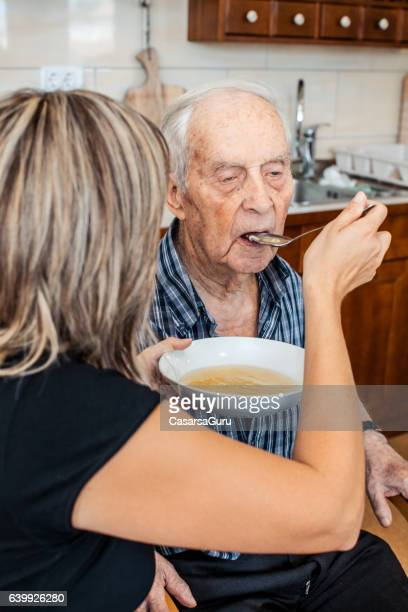 Caregiver and a Senior Man having Lunch
