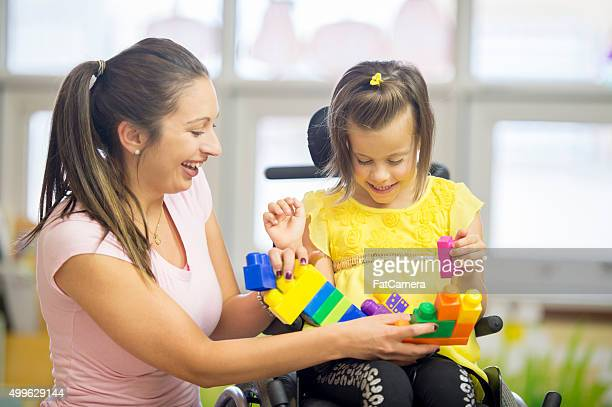 Caregiver and Little Girl Laughing Together