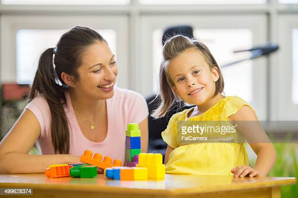 Caregiver Playing with a Special Needs Child