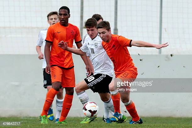 Carel Eiting of Netherlands challenges Salih Ozcan of Germany during the UEFA Under16 Tournament match between U16 Portugal v U16 Germany on February...