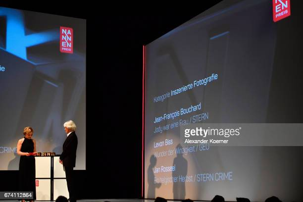 Caren Miosga and jury member Christian Irrgang speak on stage at the Nannen Award 2017 on April 27 2017 in Hamburg Germany
