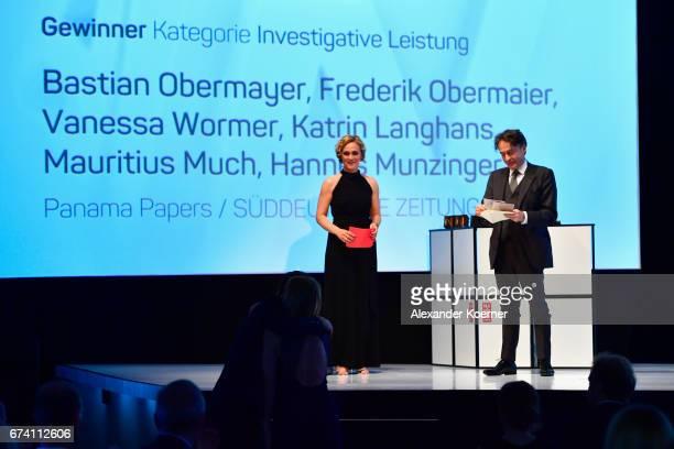 Caren Miosga and jury member Giovanni di Lorenzo speak on stage at the Nannen Award 2017 on April 27 2017 in Hamburg Germany