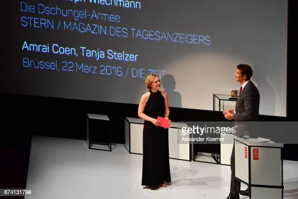 Caren Miosga and jury member Klaus Brinkbaeumer speak on stage at the Nannen Award 2017 on April 27 2017 in Hamburg Germany