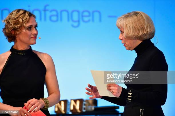 Caren Miosga and jury member Regina Schmecken speak on stage at the Nannen Award 2017 on April 27 2017 in Hamburg Germany