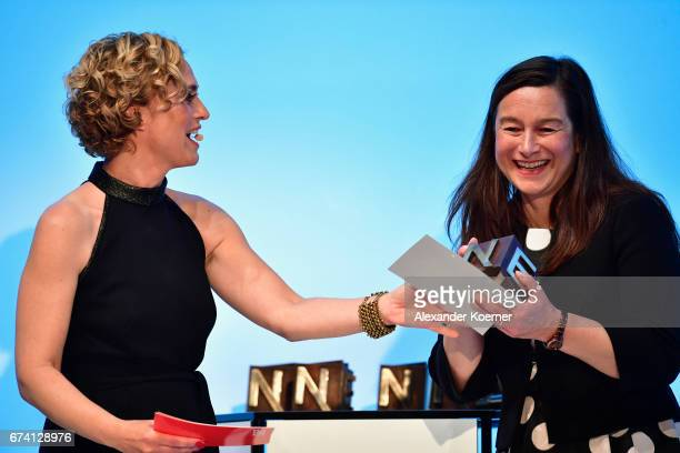Caren Miosga with STERN Art Director Frances Uckermann who accepted the 'Photography' Award on behalf of JeanFrancois Bouchard at the Nannen Award...