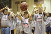 Cares summer camp participants practice their ball handling skills July 25 at Eldorado High School gym in Albuquerque New Mexico NBA legends Michael...