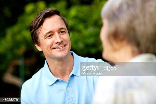 Caretaker looking at senior woman