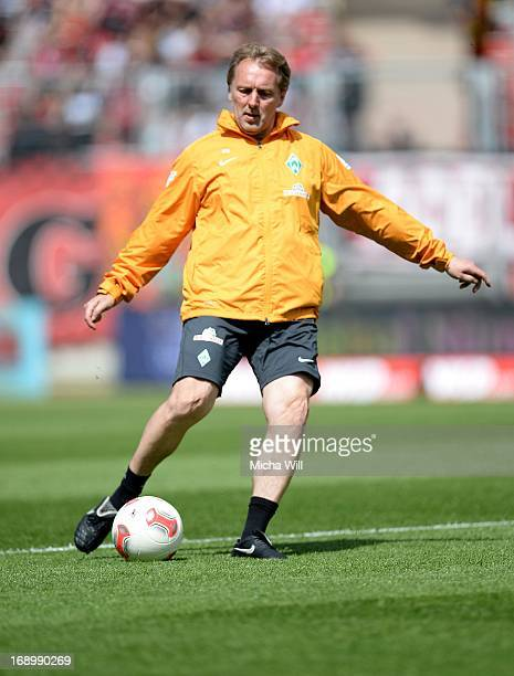 Caretaker manager Mathias Hoenerbach of Bremen shoots a ball during the warm up prior to the Bundesliga match between 1 FC Nuernberg and SV Werder...