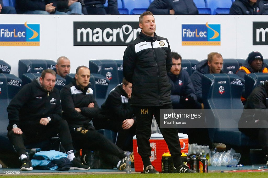 Caretaker manager Neil Harris of Millwall watches on during the Sky Bet Championship match between Bolton Wanderers and Millwall at the Macron Stadium on March 14, 2015 in Bolton, England.