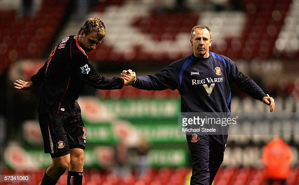 Caretaker manager of Sunderland Kevin Ball shakes hands with Chris Brown of Sunderland after their side's goaless draw and relegation in the Barclays...