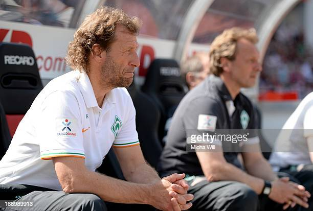 caretaker manager Wolfgang Rolff of Bremen and caretaker manager Mathias Hoenerbach of Bremen look on during the Bundesliga match between 1 FC...
