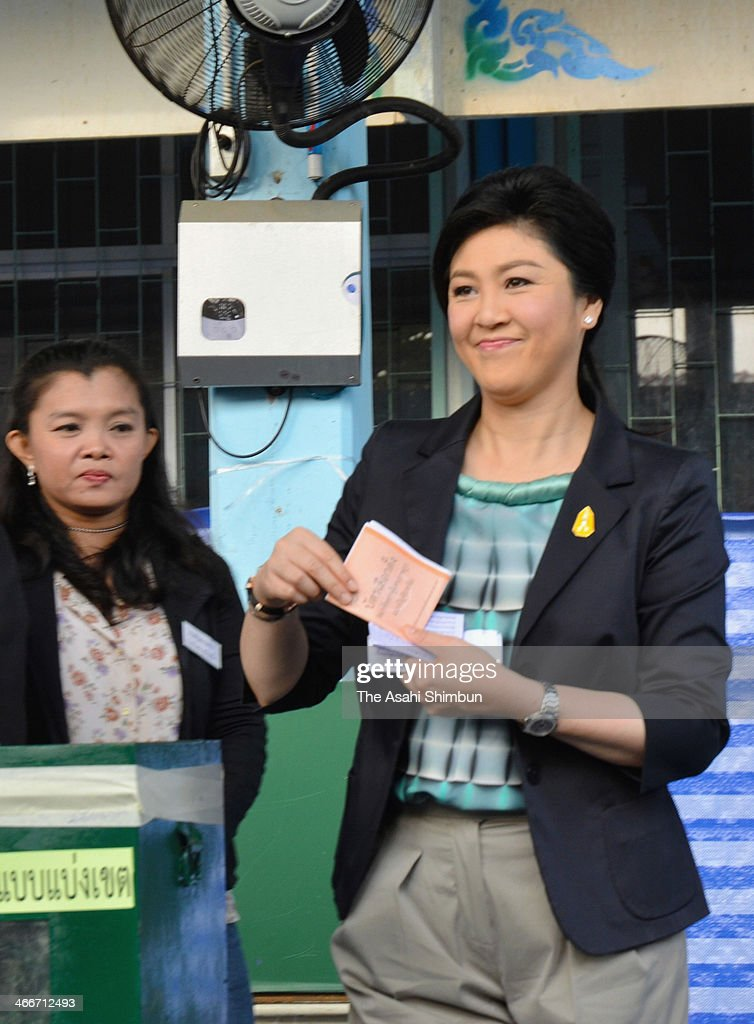 Caretaker Prime Minister of Thailand <a gi-track='captionPersonalityLinkClicked' href=/galleries/search?phrase=Yingluck+Shinawatra&family=editorial&specificpeople=787330 ng-click='$event.stopPropagation()'>Yingluck Shinawatra</a> votes during the general election on February 2, 2014 in Bangkok, Thailand. Apart from a few scuffles voting was relatively peaceful, a day after seven people were wounded by gunshots and explosions during a clash between supporters and opponents of embattled Prime Minister <a gi-track='captionPersonalityLinkClicked' href=/galleries/search?phrase=Yingluck+Shinawatra&family=editorial&specificpeople=787330 ng-click='$event.stopPropagation()'>Yingluck Shinawatra</a> in a north Bangkok stronghold of her Puea Thai Party.