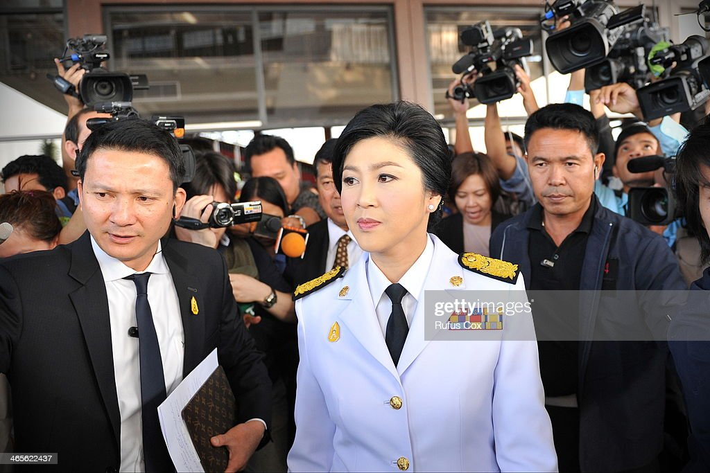 Caretaker Prime Minister <a gi-track='captionPersonalityLinkClicked' href=/galleries/search?phrase=Yingluck+Shinawatra&family=editorial&specificpeople=787330 ng-click='$event.stopPropagation()'>Yingluck Shinawatra</a> leaves a military compound after a cabinet meeting where it was decided to go ahead with the general election on January 28, 2014 in Bangkok, Thailand. Amid a government declared state of emergency and ongoing political rallies the caretaker administration decided to proceed with the February 2nd snap-poll. Bangkok Shutdown protests have continued in the capital for over two weeks, aimed at toppling the government and derailing the election.