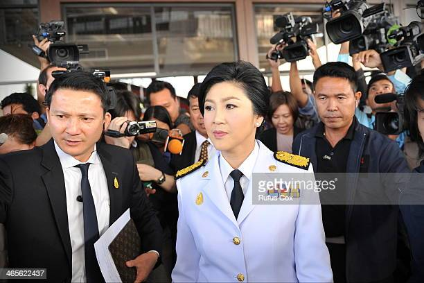Caretaker Prime Minister Yingluck Shinawatra leaves a military compound after a cabinet meeting where it was decided to go ahead with the general...