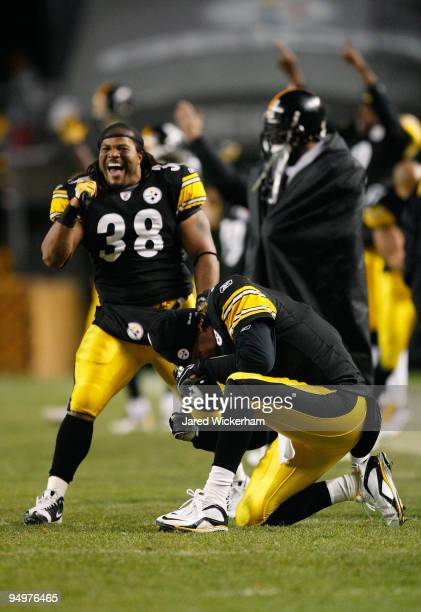 Carey Davis and Ben Roethlisberger of the Pittsburgh Steelers celebrate after the game winning touchdown against the Green Bay Packers was confirmed...
