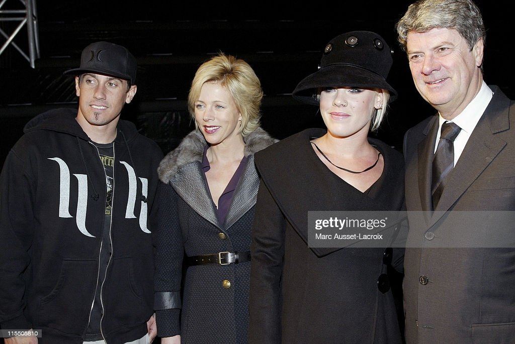 Carey Hart and Pink with Yves Carcelle the CEO of Louis Vuitton