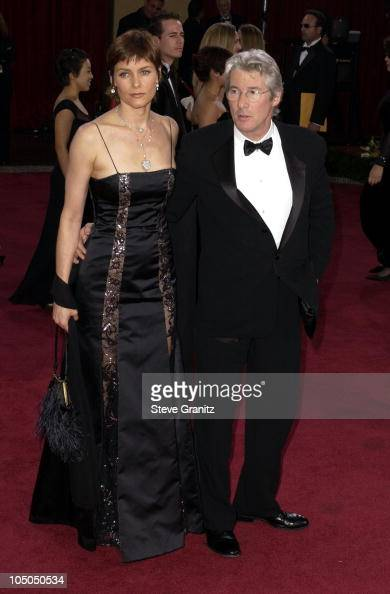 Carey Lowell and Richard Gere during The 75th Annual Academy Awards Arrivals at The Kodak Theater in Hollywood California United States