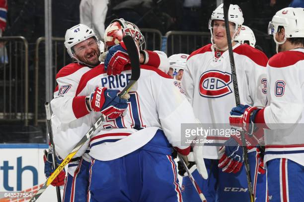 Carey Price and Alexander Radulov of the Montreal Canadiens celebrate after defeating the New York Rangers 32 in a shootout at Madison Square Garden...