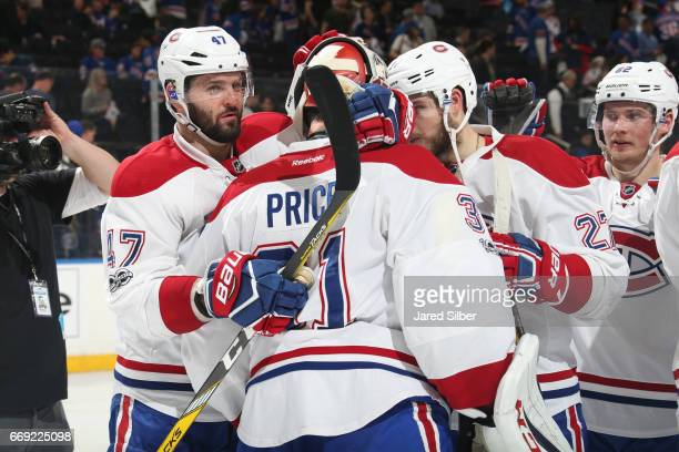 Carey Price and Alexander Radulov of the Montreal Canadiens celebrate after defeating the New York Rangers 31 in Game Three of the Eastern Conference...
