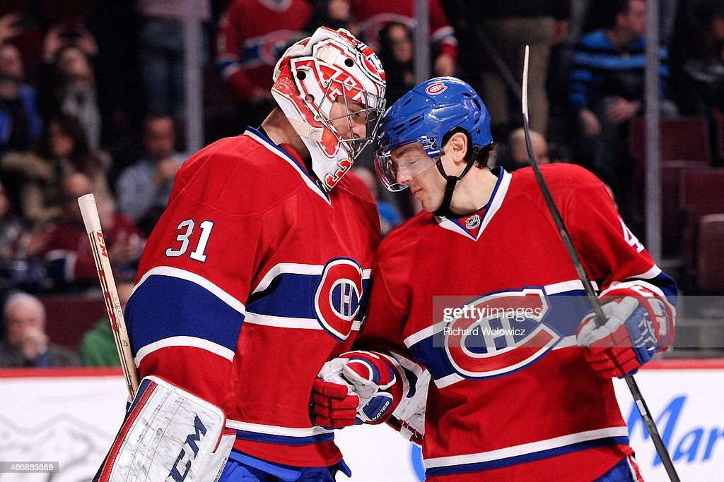 <a gi-track='captionPersonalityLinkClicked' href=/galleries/search?phrase=Carey+Price&family=editorial&specificpeople=2222083 ng-click='$event.stopPropagation()'>Carey Price</a> #31 and <a gi-track='captionPersonalityLinkClicked' href=/galleries/search?phrase=Daniel+Briere&family=editorial&specificpeople=201624 ng-click='$event.stopPropagation()'>Daniel Briere</a> #48 of the Montreal Canadiens celebrate after defeating the Calgary Flames 2-0 in an NHL game at the Bell Centre on February 4, 2014 in Montreal, Quebec, Canada. The Canadiens defeated the Flames 2-0.