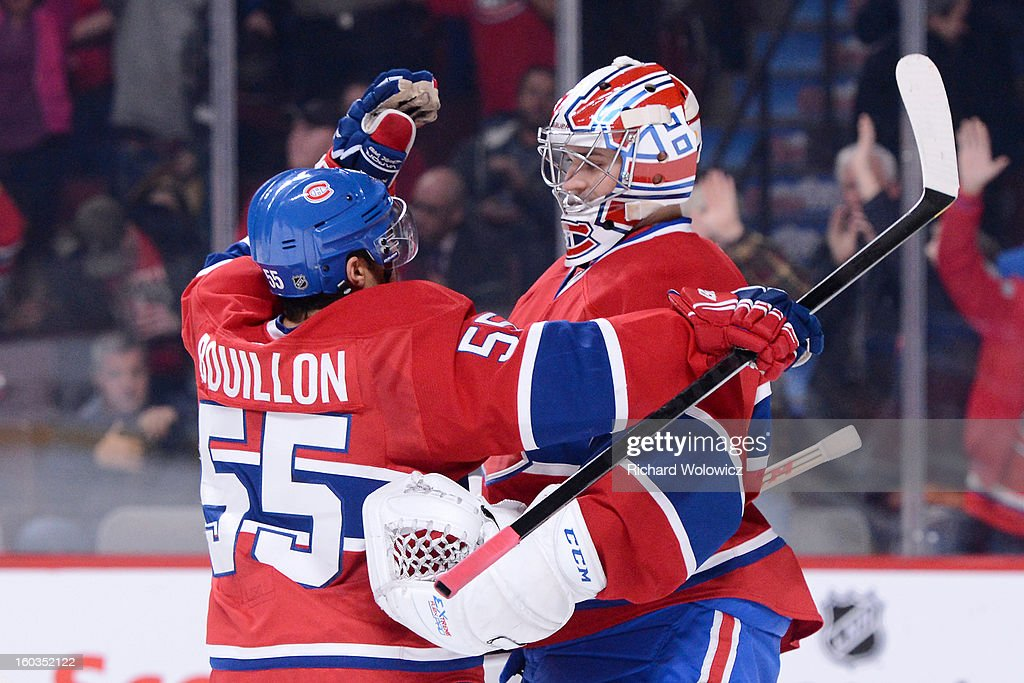 <a gi-track='captionPersonalityLinkClicked' href=/galleries/search?phrase=Carey+Price&family=editorial&specificpeople=2222083 ng-click='$event.stopPropagation()'>Carey Price</a> #31 and <a gi-track='captionPersonalityLinkClicked' href=/galleries/search?phrase=Francis+Bouillon&family=editorial&specificpeople=215165 ng-click='$event.stopPropagation()'>Francis Bouillon</a> #55 of the Montreal Canadiens celebrate after defeating the Winnipeg Jets in their NHL game at the Bell Centre on January 29, 2013 in Montreal, Quebec, Canada. The Canadiens defeated the Jets 4-3.
