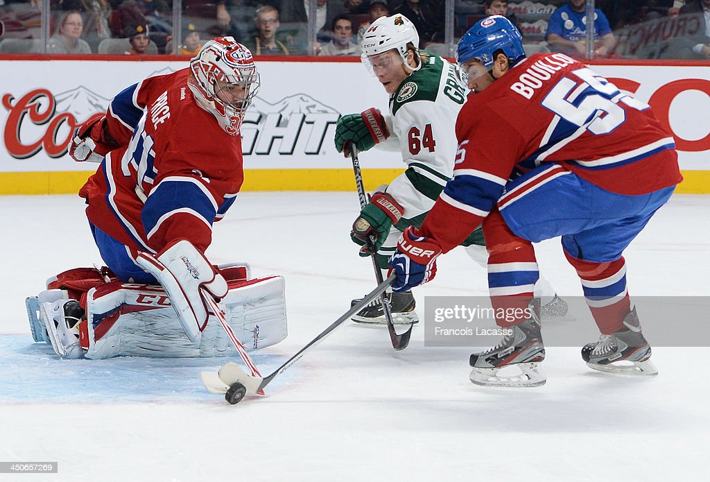 Carey Price #31 and Francis Bouillon #55 of the Montreal Canadiens defend the goal against Mikael Granlund #64 of the Minnesota Wild during the NHL game on November 19, 2013 at the Bell Centre in Montreal, Quebec, Canada.