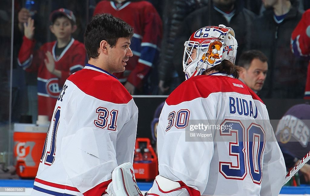 <a gi-track='captionPersonalityLinkClicked' href=/galleries/search?phrase=Carey+Price&family=editorial&specificpeople=2222083 ng-click='$event.stopPropagation()'>Carey Price</a> #31 and <a gi-track='captionPersonalityLinkClicked' href=/galleries/search?phrase=Peter+Budaj&family=editorial&specificpeople=228123 ng-click='$event.stopPropagation()'>Peter Budaj</a> #30 of the Montreal Canadiens skate off the the ice after a 5-1 victory over the Buffalo Sabres on April 11, 2013 at the First Niagara Center in Buffalo, New York.