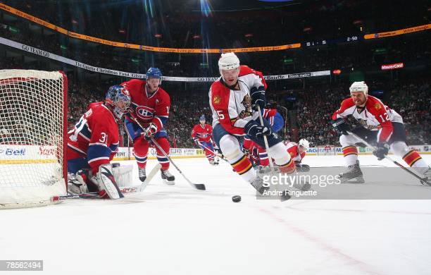 Carey Price and Saku Koivu of the Montreal Canadiens defend against Jozef Stumpel and Olli Jokinen of the Florida Panthers at the Bell Centre on...