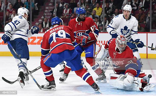 Carey Price Andrei Markov and PK Subban of the Montreal Canadiens defend the goal against Leo Komarov and James van Riemsdyk of the Toronto Maple...