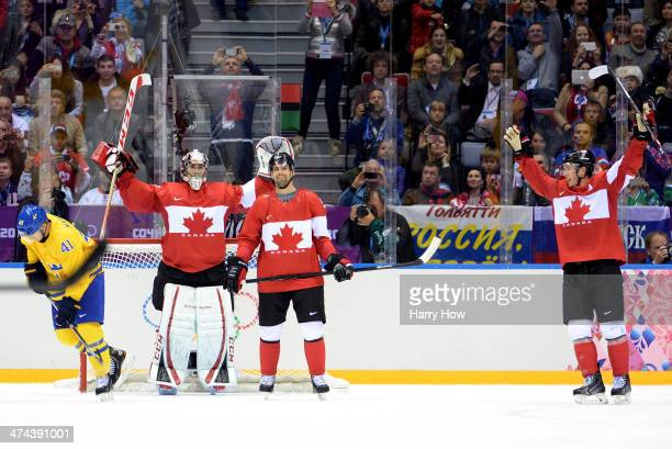 Carey Price Dan Hamhuis and Jonathan Toews of Canada celebrate after defeating Sweden 30 during the Men's Ice Hockey Gold Medal match on Day 16 of...