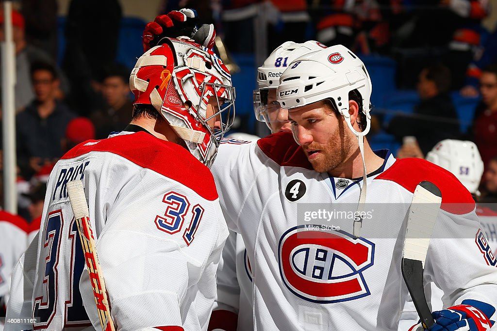 <a gi-track='captionPersonalityLinkClicked' href=/galleries/search?phrase=Carey+Price&family=editorial&specificpeople=2222083 ng-click='$event.stopPropagation()'>Carey Price</a> #31 is congratulated by teammate <a gi-track='captionPersonalityLinkClicked' href=/galleries/search?phrase=Brandon+Prust&family=editorial&specificpeople=2221796 ng-click='$event.stopPropagation()'>Brandon Prust</a> #8 of the Montreal Canadiens after defeating the New York Islanders at Nassau Veterans Memorial Coliseum on December 23, 2014 in Uniondale, New York. The Montreal Canadiens defeated the New York Islanders 3-1.