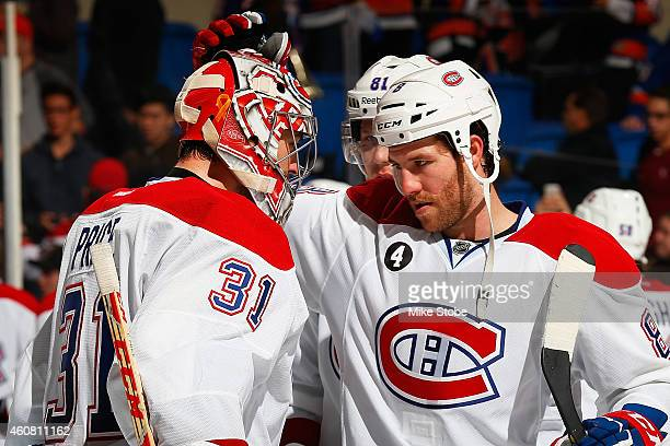 Carey Price is congratulated by teammate Brandon Prust of the Montreal Canadiens after defeating the New York Islanders at Nassau Veterans Memorial...