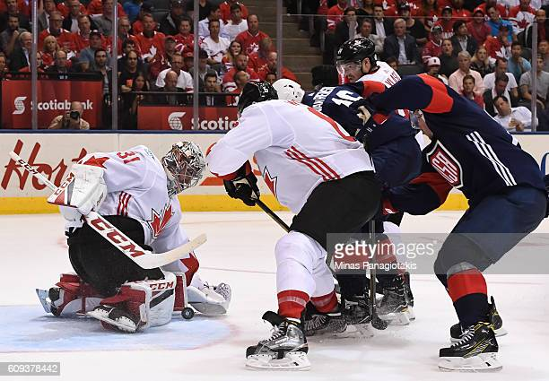Carey Price makes a save with Shea Weber of Team Canada and James Van Riemsdyk of Team USA battling in front during the World Cup of Hockey 2016 at...