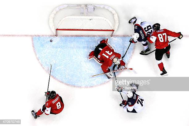 Carey Price of Canada makes a save against TJ Oshie and Paul Stastny of the United States during the Men's Ice Hockey Semifinal Playoff on Day 14 of...