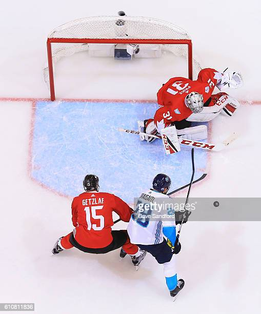 Carey Price of Team Canada makes a save against Leon Draisaitl of Team Europe as Ryan Getzlaf of Team Canada defends during Game One of the World Cup...