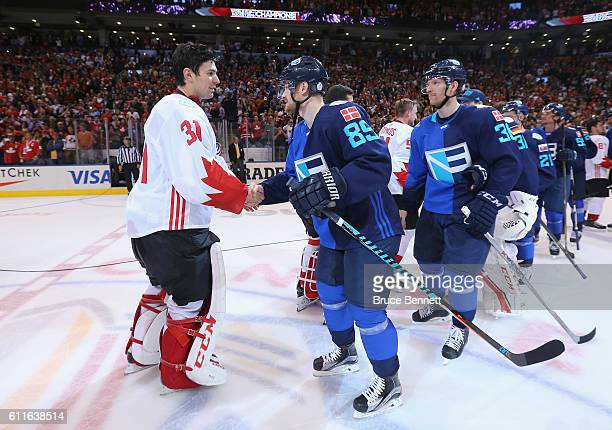 Carey Price of Team Canada shakes hands with Mikkel Boedker of Team Europe following Game Two of the World Cup of Hockey final series at the Air...