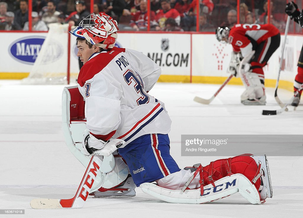 <a gi-track='captionPersonalityLinkClicked' href=/galleries/search?phrase=Carey+Price&family=editorial&specificpeople=2222083 ng-click='$event.stopPropagation()'>Carey Price</a> #31 of the Montreal Canadiens and <a gi-track='captionPersonalityLinkClicked' href=/galleries/search?phrase=Ben+Bishop&family=editorial&specificpeople=700137 ng-click='$event.stopPropagation()'>Ben Bishop</a> #30 of the Ottawa Senators focus as the ice is being prepared for the shoot-out on February 25, 2013 at Scotiabank Place in Ottawa, Ontario, Canada.
