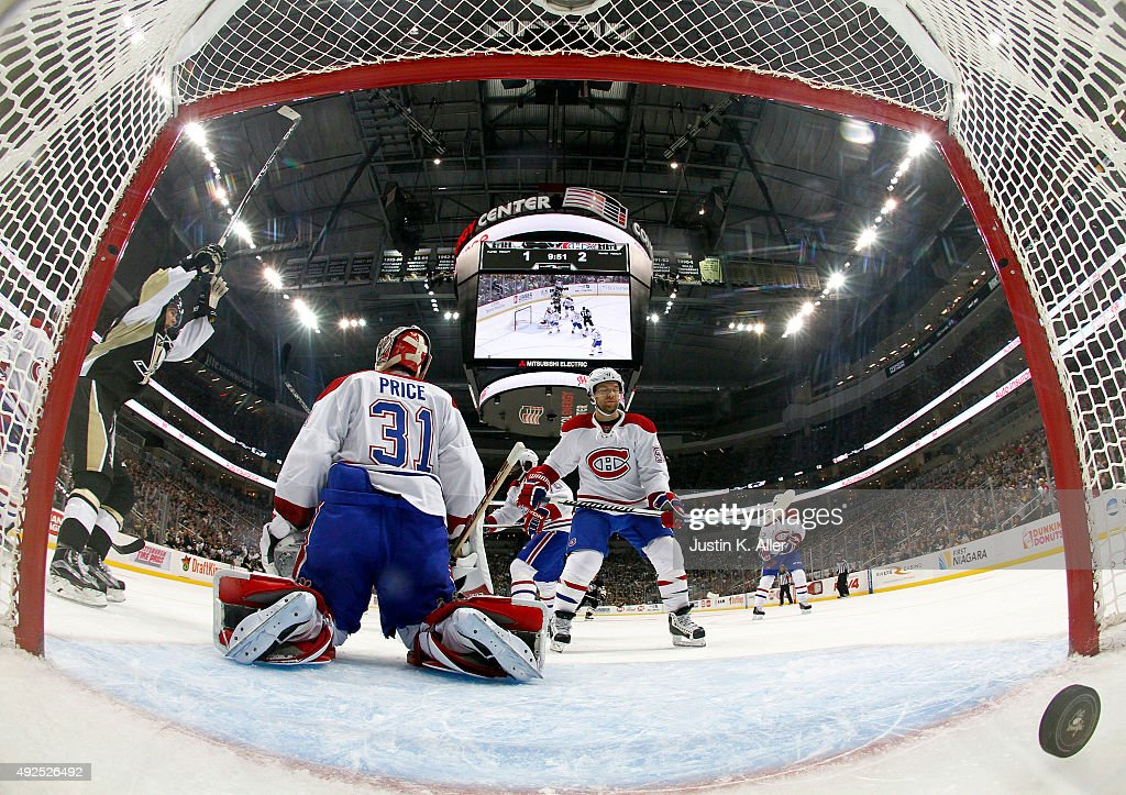 <a gi-track='captionPersonalityLinkClicked' href=/galleries/search?phrase=Carey+Price&family=editorial&specificpeople=2222083 ng-click='$event.stopPropagation()'>Carey Price</a> #31 of the Montreal Canadiens and <a gi-track='captionPersonalityLinkClicked' href=/galleries/search?phrase=David+Desharnais&family=editorial&specificpeople=4084305 ng-click='$event.stopPropagation()'>David Desharnais</a> #51 react after allowing a second period goal by Kris Letang #58 of the Pittsburgh Penguins (not pictured) during the game against the Pittsburgh Penguins at Consol Energy Center on October 13, 2015 in Pittsburgh, Pennsylvania.