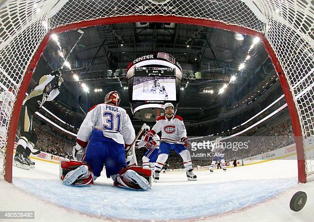Carey Price of the Montreal Canadiens and David Desharnais react after allowing a second period goal by Kris Letang of the Pittsburgh Penguins during...