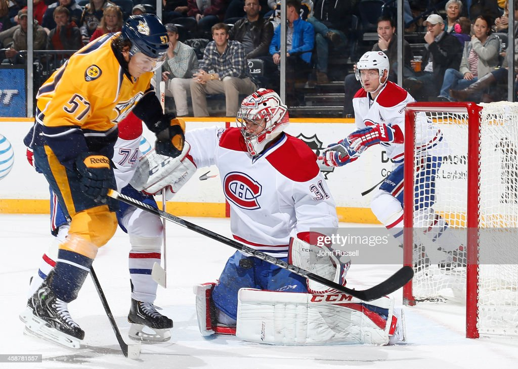 <a gi-track='captionPersonalityLinkClicked' href=/galleries/search?phrase=Carey+Price&family=editorial&specificpeople=2222083 ng-click='$event.stopPropagation()'>Carey Price</a> #31 of the Montreal Canadiens blocks a shot against <a gi-track='captionPersonalityLinkClicked' href=/galleries/search?phrase=Gabriel+Bourque&family=editorial&specificpeople=5627917 ng-click='$event.stopPropagation()'>Gabriel Bourque</a> #57 of the Nashville Predators at Bridgestone Arena on December 21, 2013 in Nashville, Tennessee.