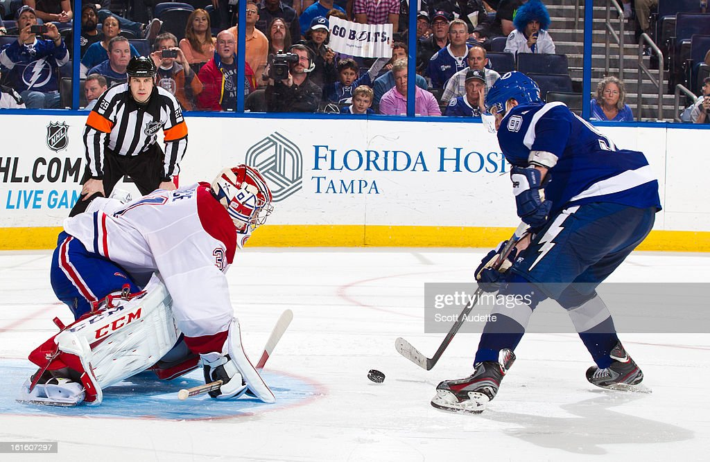 <a gi-track='captionPersonalityLinkClicked' href=/galleries/search?phrase=Carey+Price&family=editorial&specificpeople=2222083 ng-click='$event.stopPropagation()'>Carey Price</a> #31 of the Montreal Canadiens blocks <a gi-track='captionPersonalityLinkClicked' href=/galleries/search?phrase=Steven+Stamkos&family=editorial&specificpeople=4047623 ng-click='$event.stopPropagation()'>Steven Stamkos</a> #91 of the Tampa Bay Lightning from scoring during a shoot-out in overtime of the game at the Tampa Bay Times Forum on February 12, 2013 in Tampa, Florida.