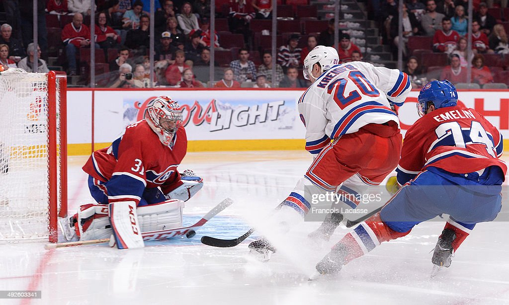 Carey Price #31 of the Montreal Canadiens blocks the shot by Chris Kreider #20 of the New York Rangers challenged by Alexei Emelin #74 in Game One of the Eastern Conference Final during the 2014 Stanley Cup Playoffs at the Bell Centre on May 17, 2014 in Montreal, Quebec, Canada.